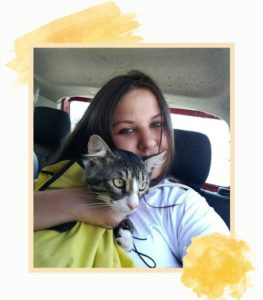 Girl with a cat in a car