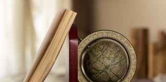 Travel books and a globe