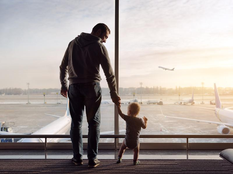 Father with a kid on airport